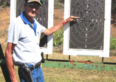 main pointing at a shooting target