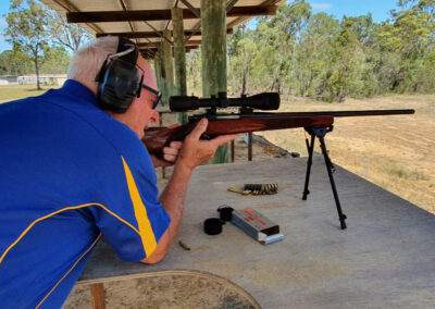 man aiming a shotgun on the range
