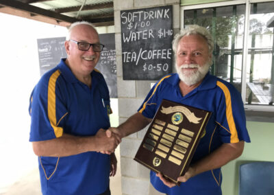 shooter accepting an award at fraser coast pistol club