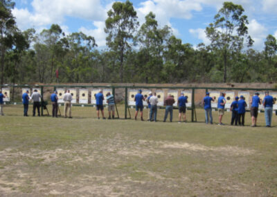 shooters inspecting their targets at the fraser coast pistol club