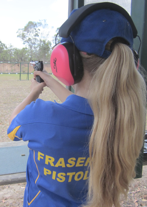 young girl shooting a target at the fraser coast pistol club - hervey bay shooting range